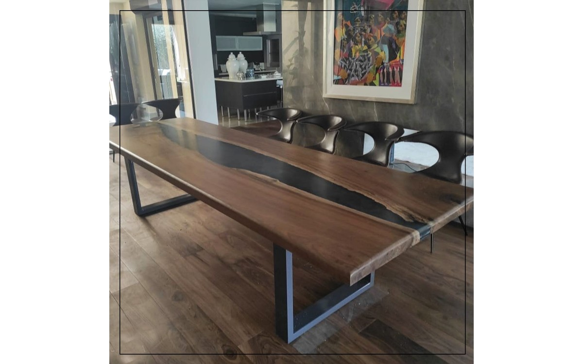 Walnut dining table with epoxy